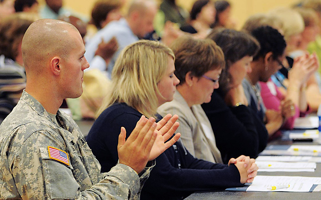 Veteran at a conference with civilian attendees