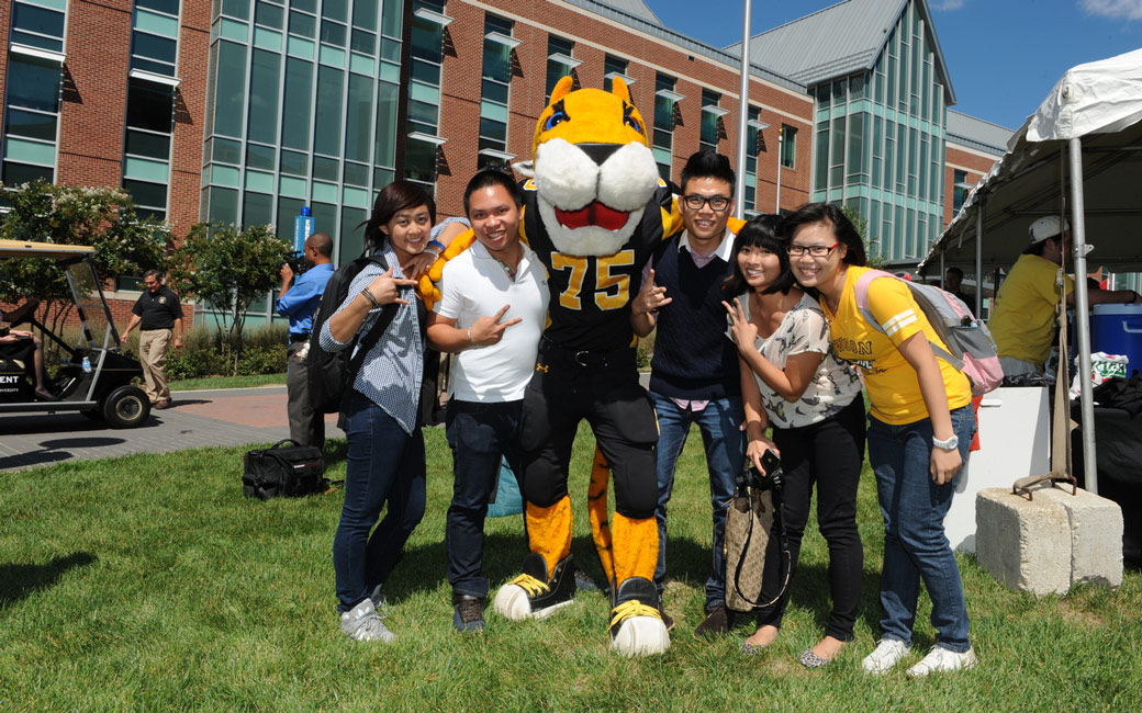 international students with doc outside