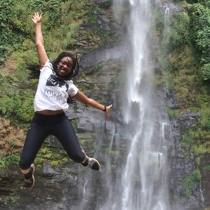 Student at waterfall in Ghana