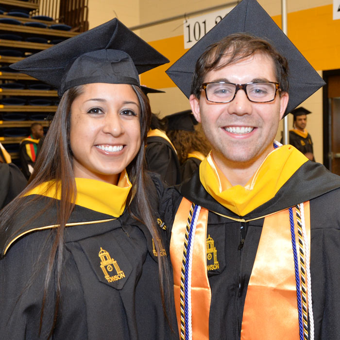 A female and male student at Commencement