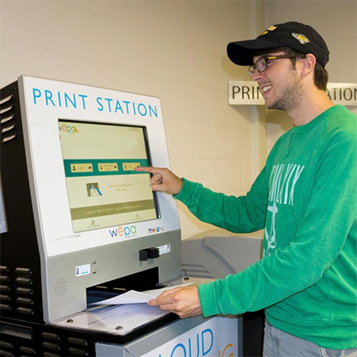 male at printing kiosk
