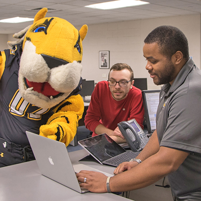 mascot and student assisted at the SCS Service Desk