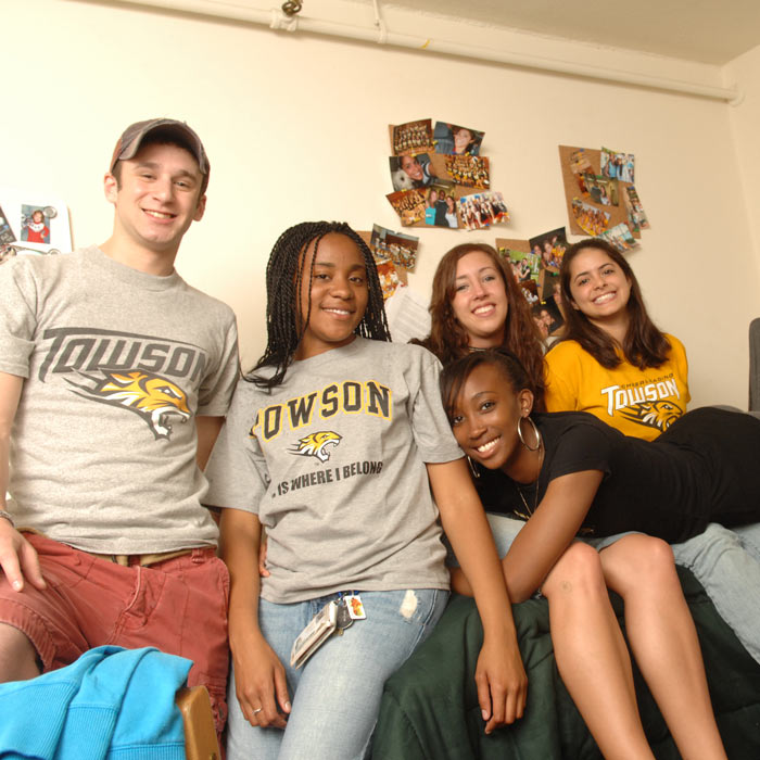 group of students in dorm room