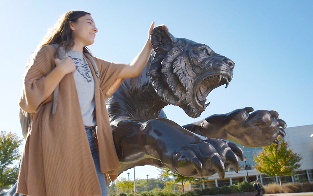 Video of female student and TU tiger statue