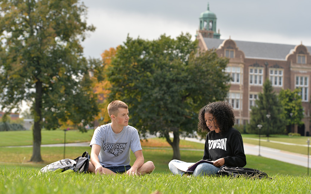 Two TU students sitting in field