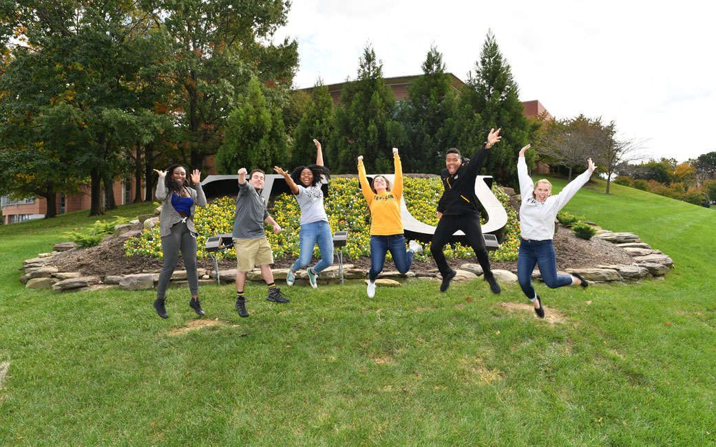 Students on Campus Jumping in Air