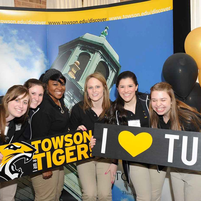 students with Towson signs
