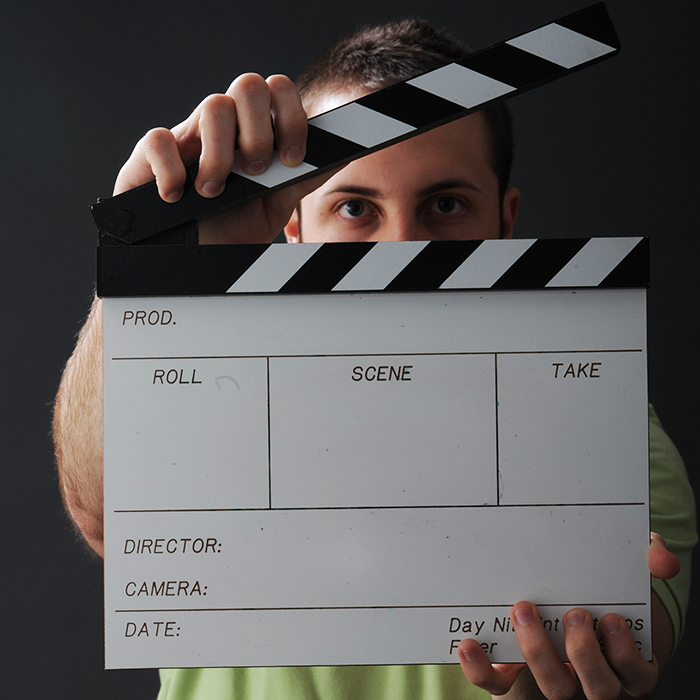 Student with film clapboard
