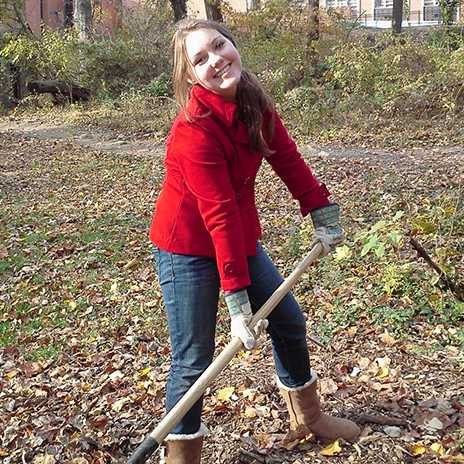 A student worker in the Glen Arboretum.