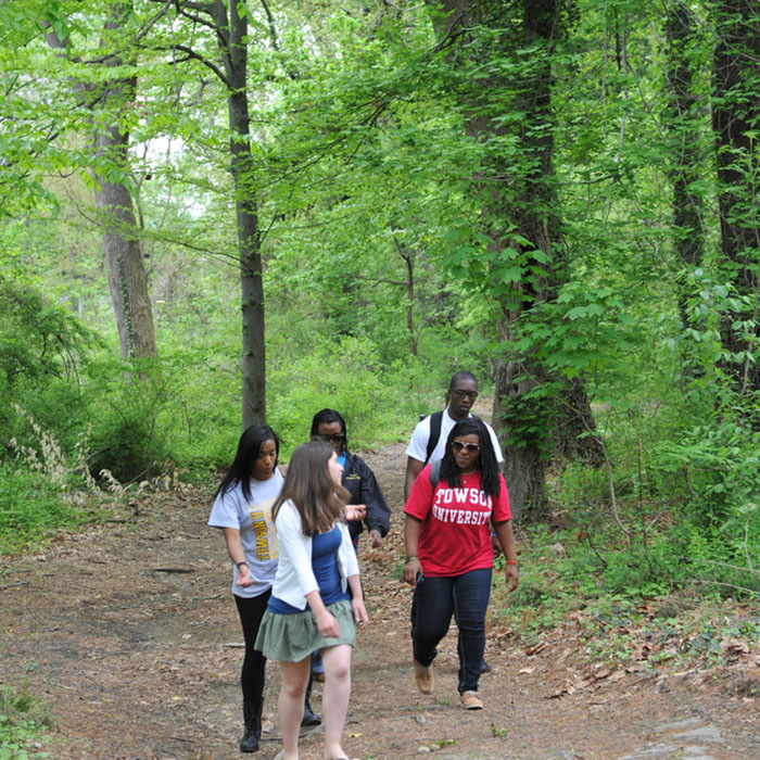 Students walking in the Glen Arboretum