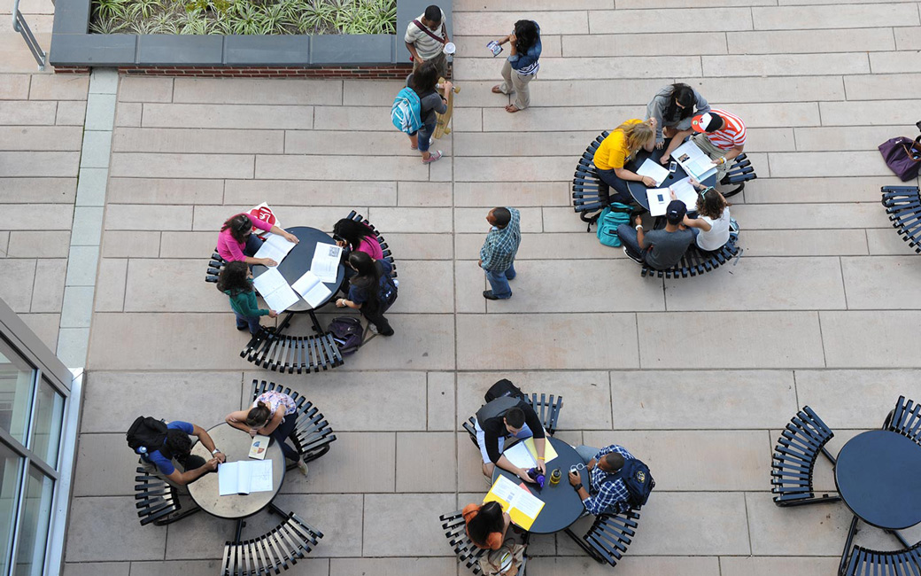 Overhead view of students outside seated at tables