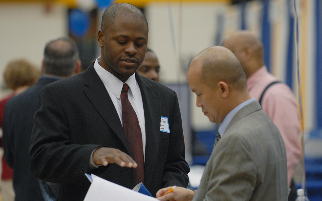 Employer talking with student at career fair