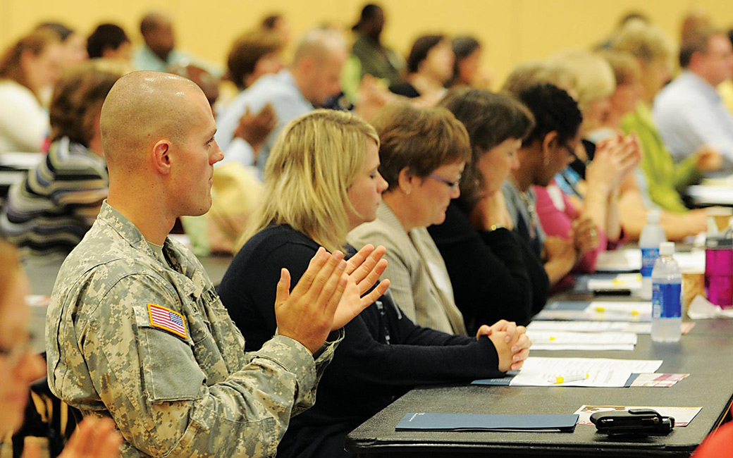 Veteran student clapping at conference