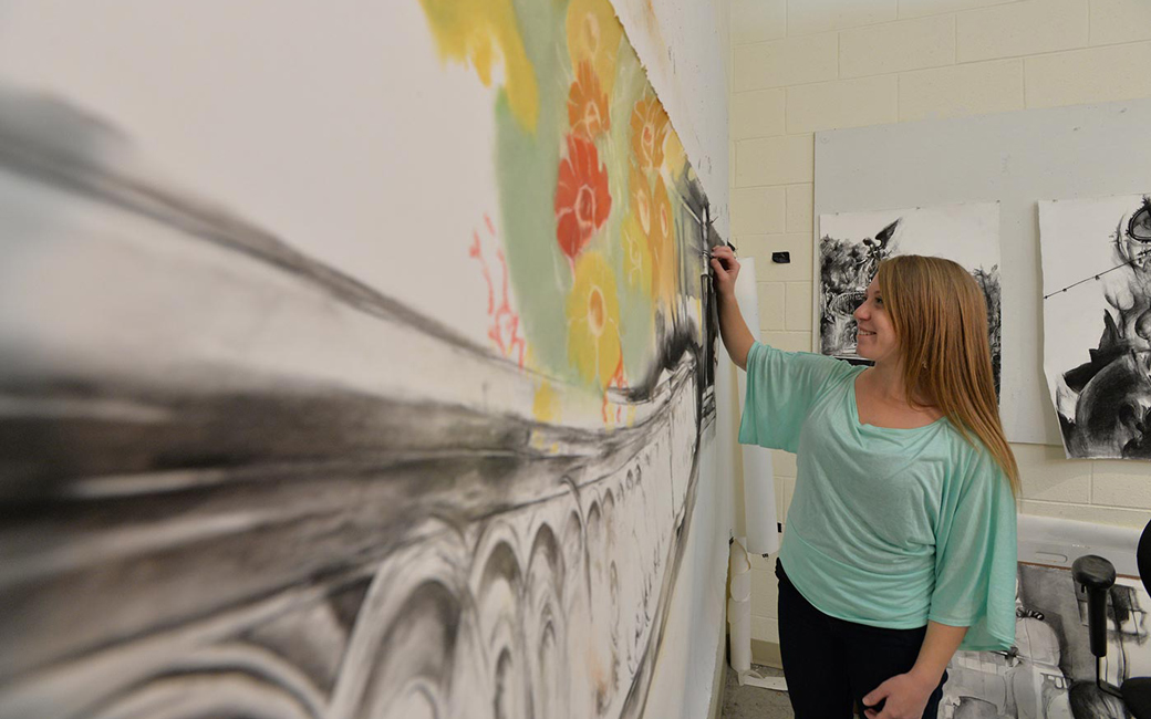 Student artist drawing on board