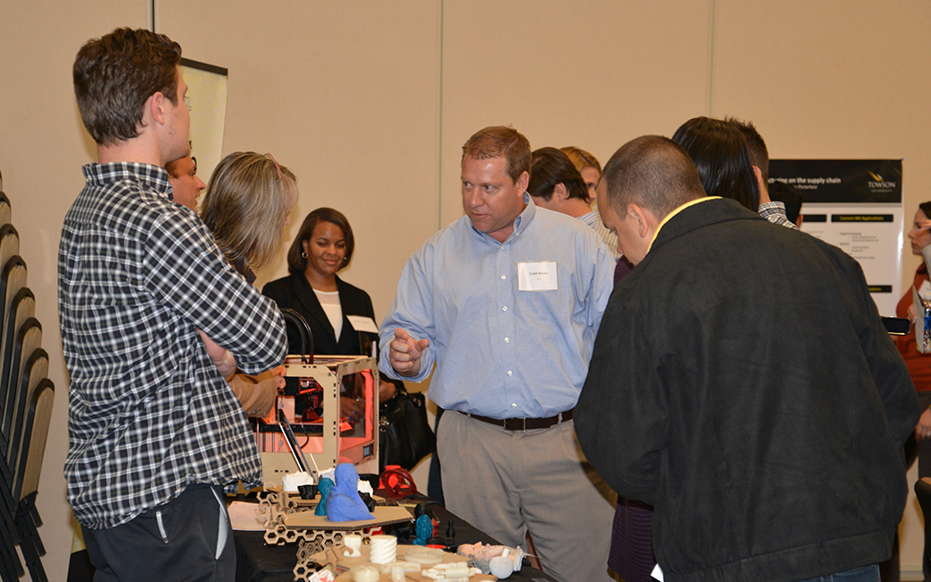 Towson University students demonstrate the prototyping capabilities of 3D printers at the 2013 Supply Chain Forum.