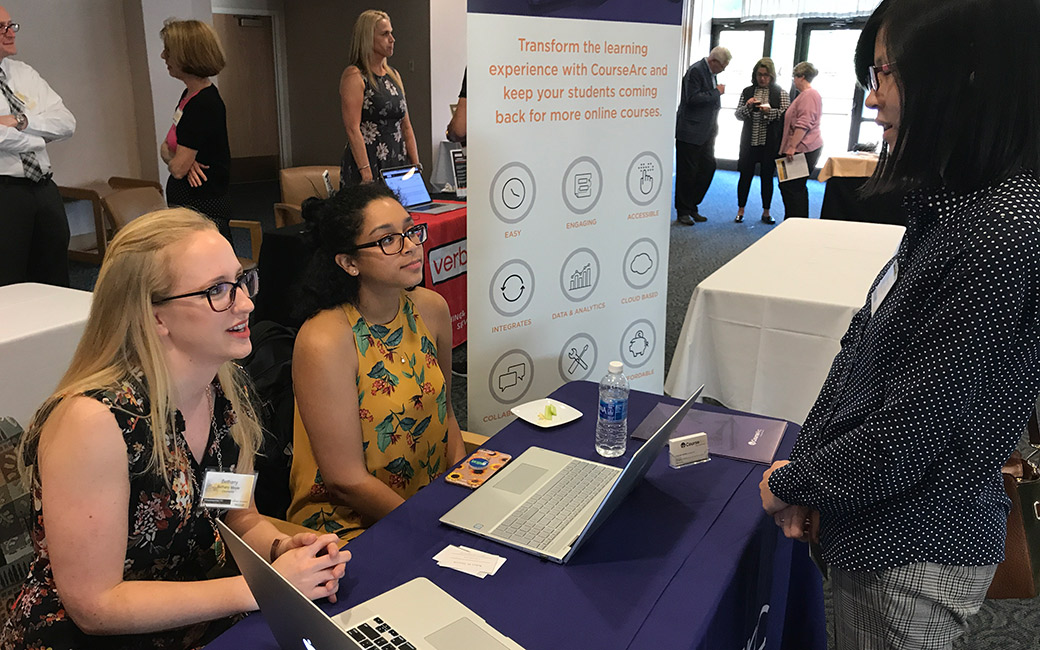 exhibitors talk to attendees at the demo day 2018 event