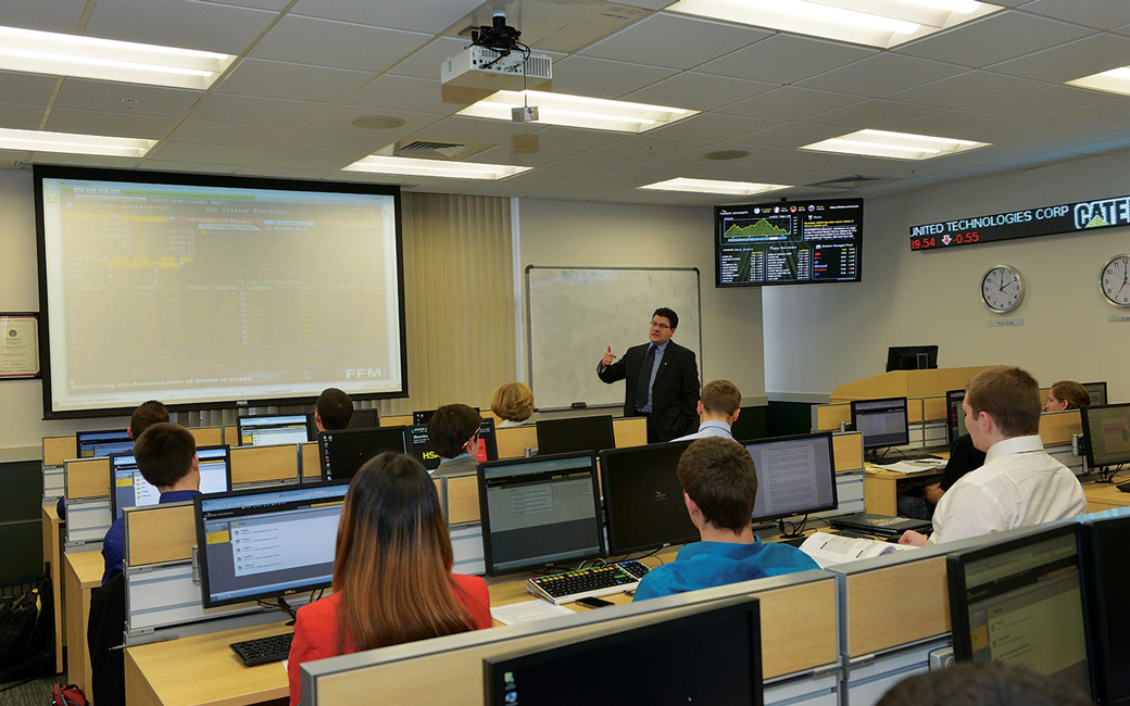 Professor Dewally teaches a class in the T. Rowe Price Finance Lab