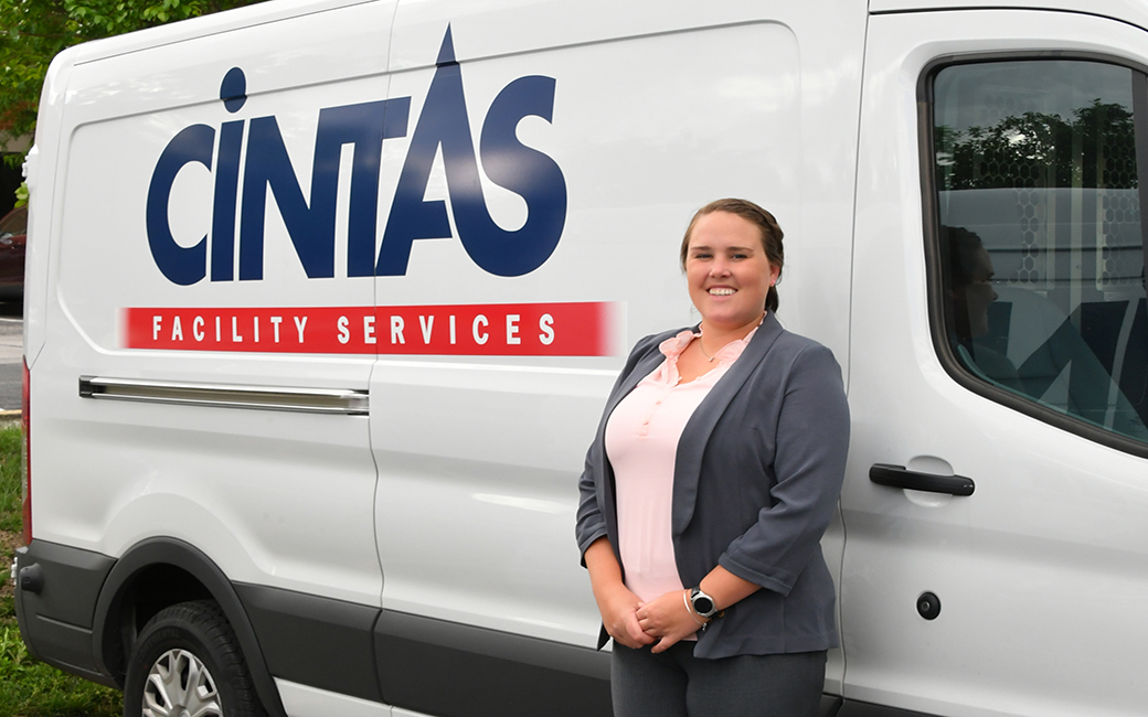 Jillian standing next to a Cintas truck