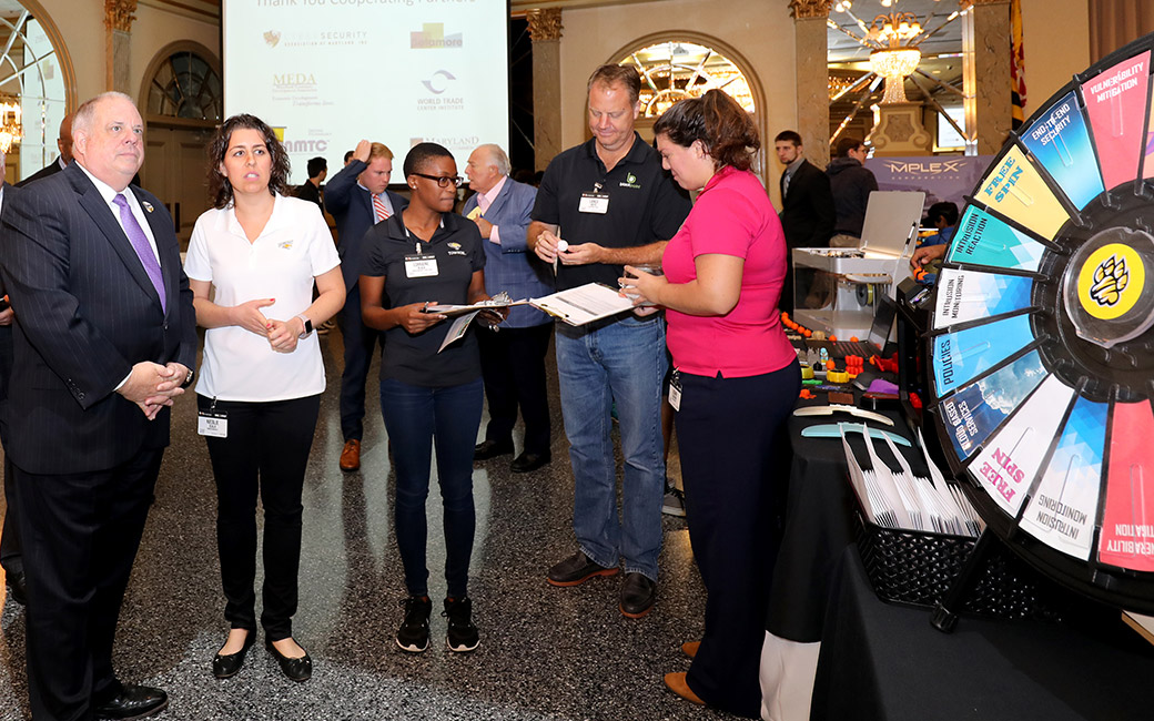 Students and professors share cyber security project at Manufacturing Day.