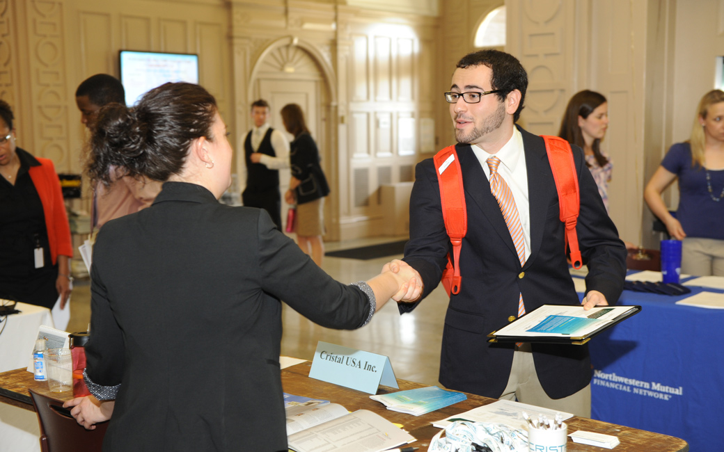 Student shaking hands with employer at the CBE career fair