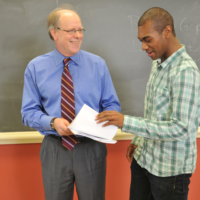 FAculty member helping business student