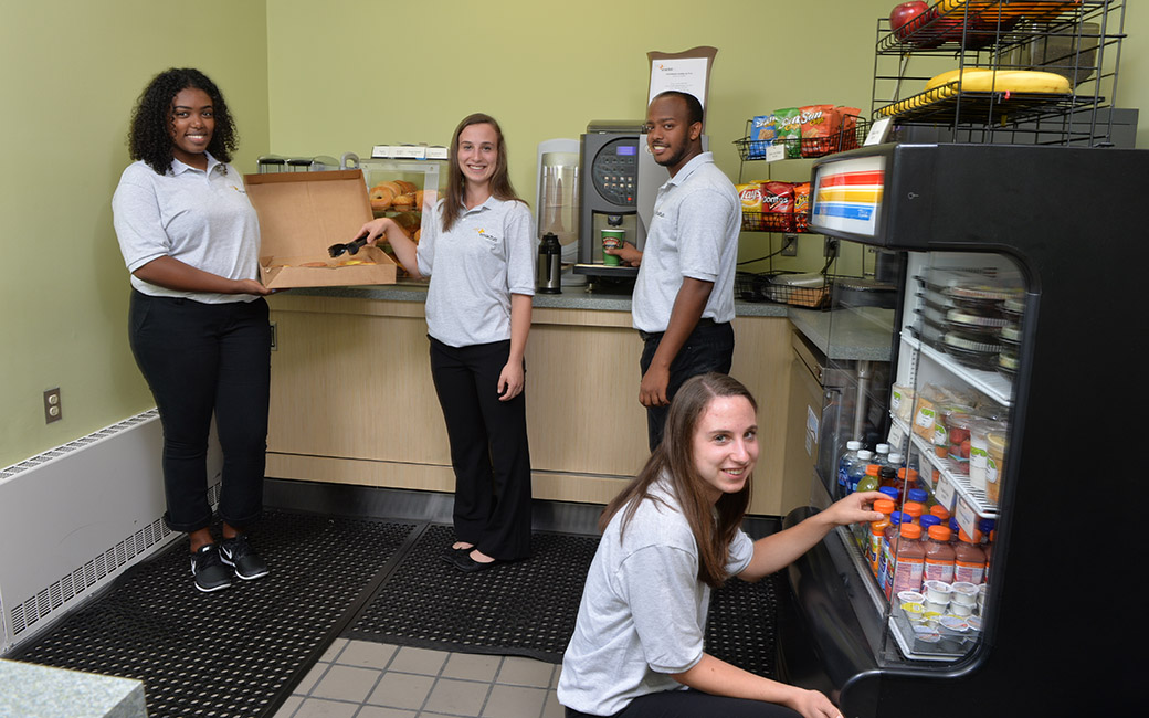 Enactus leaders stock items in their cafe in Stephens Hall, which was recently placed in two nationwide competitions.