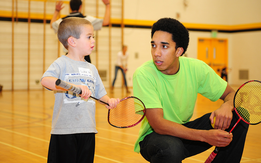 TU Phys Ed/Teacher Ed student working with a child