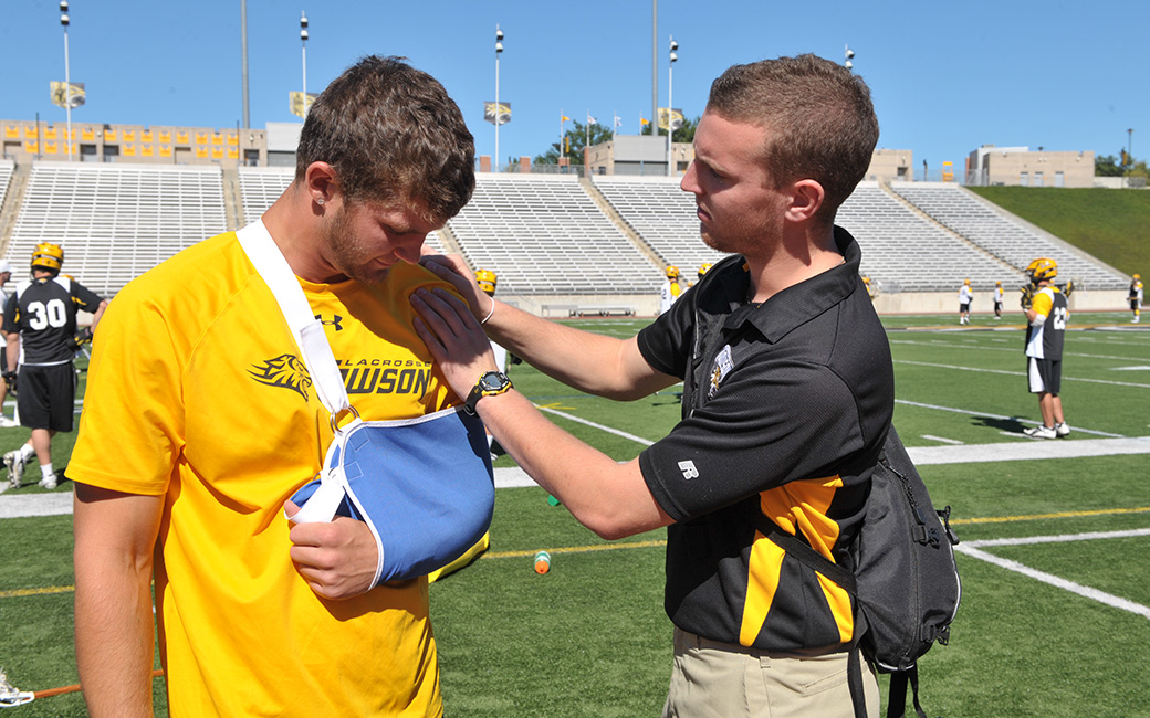 Athletic training students providing care for student athletes