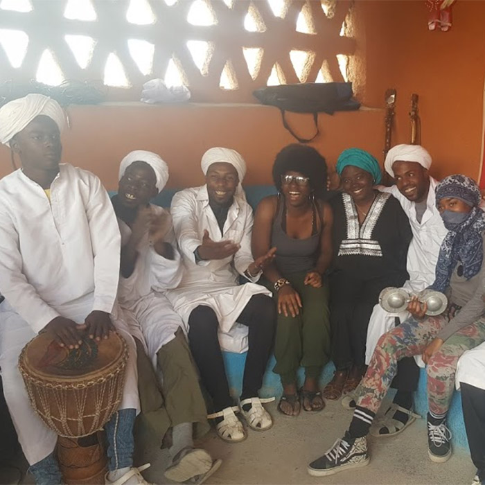 Chenise Calhoun with musicians in Morocco