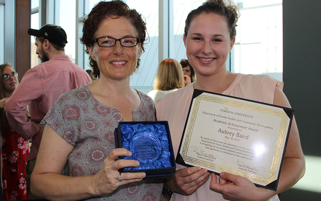 Student with an achievement award