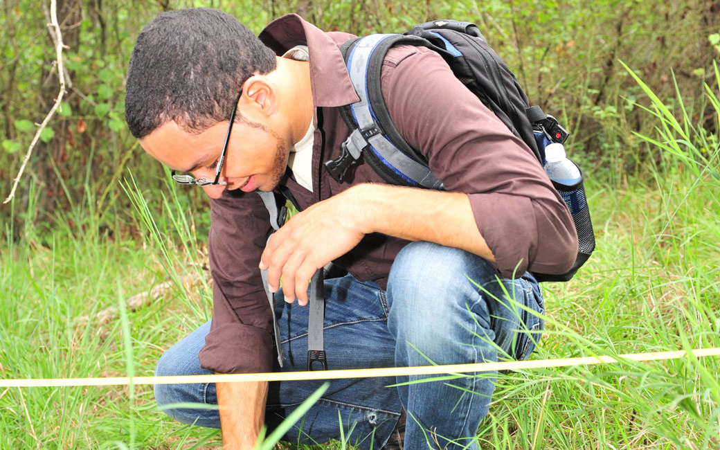 Student outside participating in fieldwork