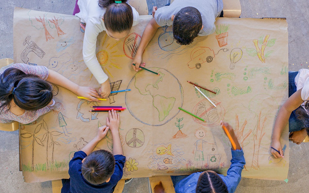 Children drawing image of globe