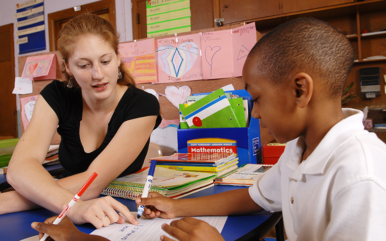 TU student teaching a child