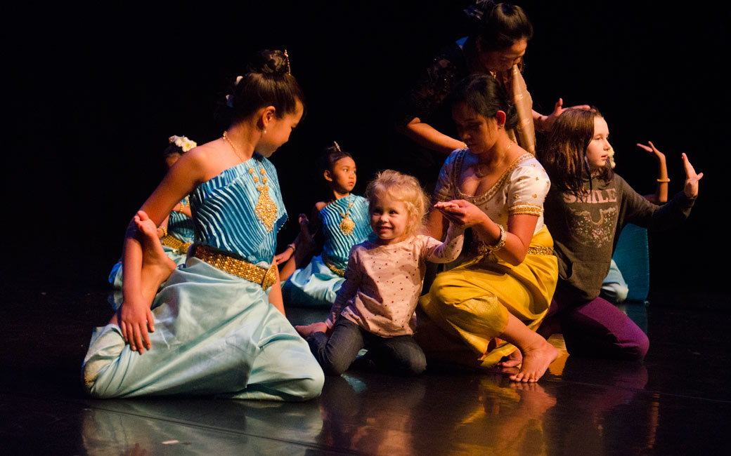 Dancers from the Cambodian American Heritage Dance Troupe work with children during Family Art Day, Nov. 2015