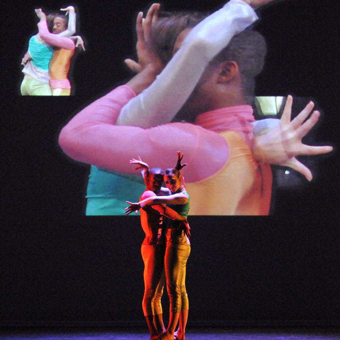 dancers in front of projected image