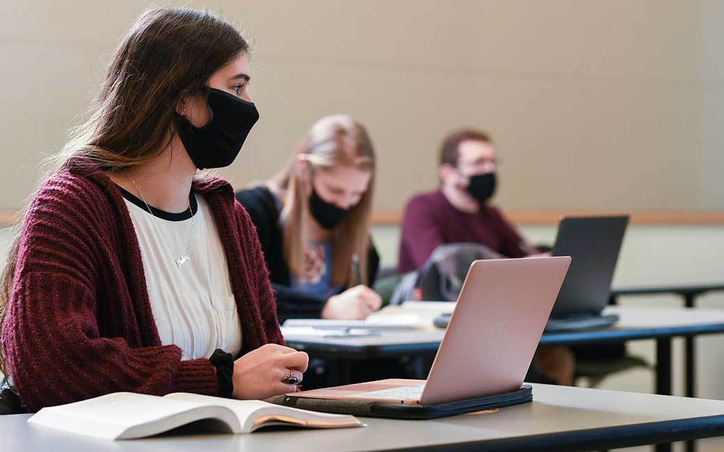 students in class wearing masks