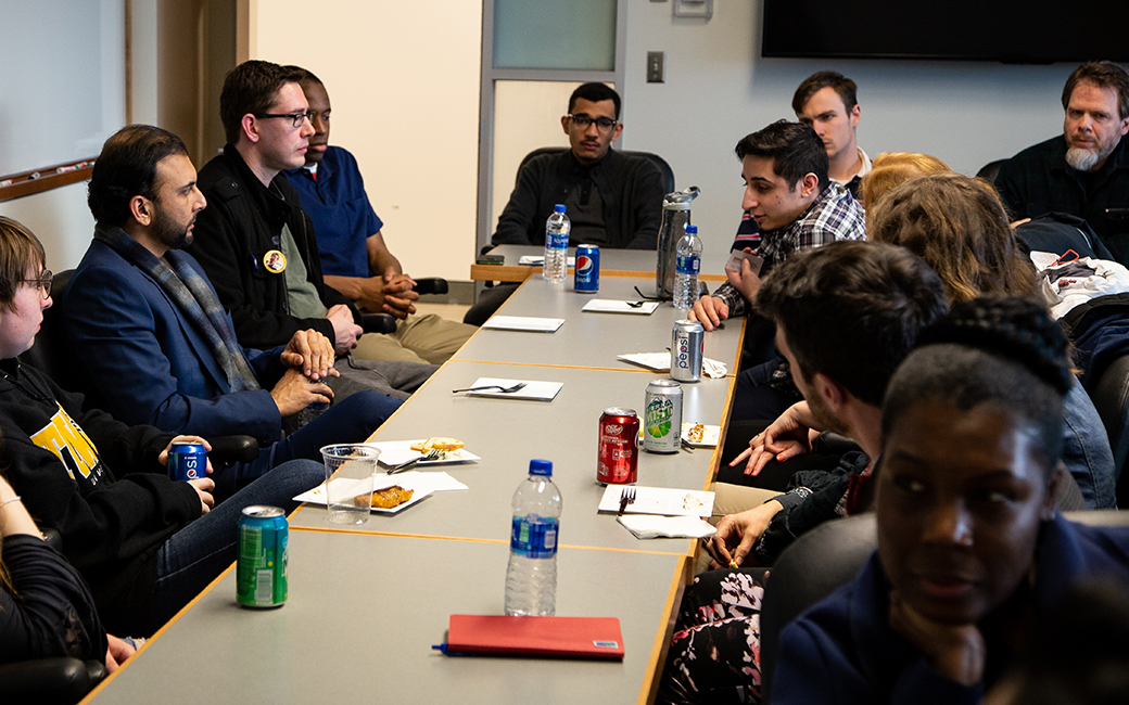 Qasim Rashid speaking with TU students