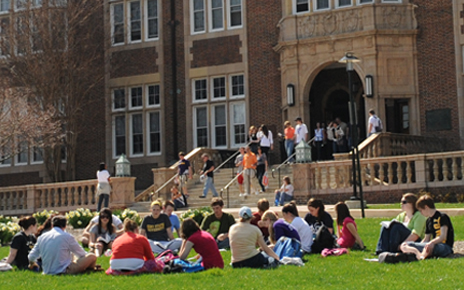 large groups of towson students sitting on grass in front of Stephens Hall