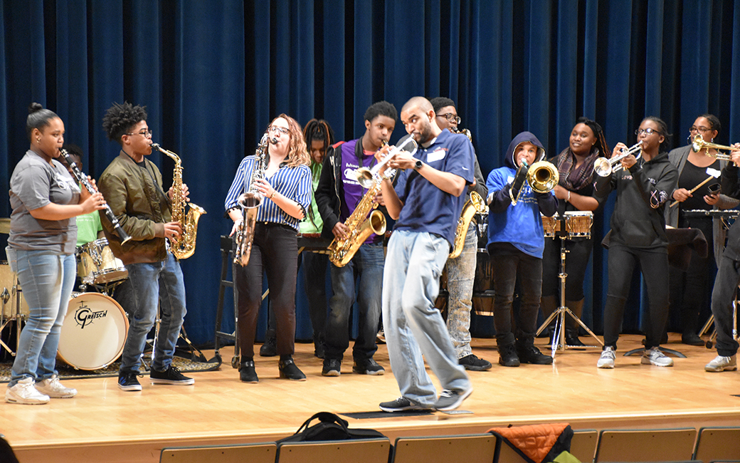 A diverse group of high school students playing jazz band on stage