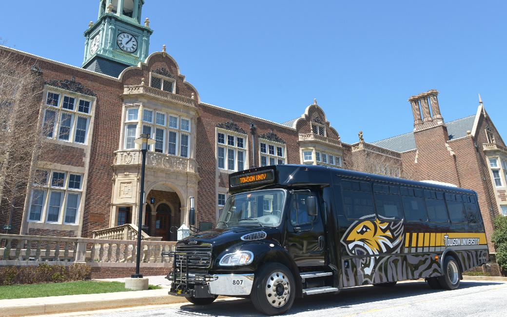 Towson university shuttle parked outside Stephen's Hall