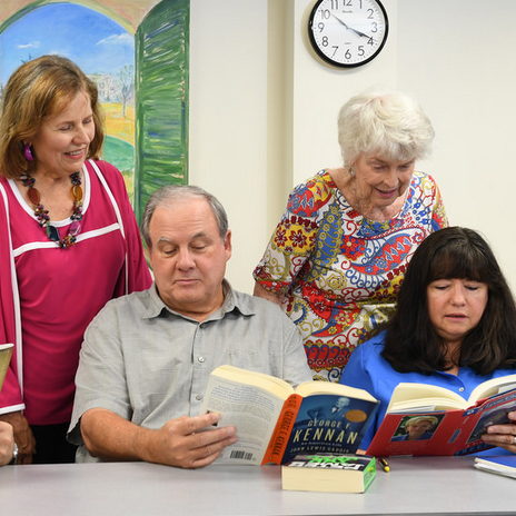 Four Osher members discussing during a book club