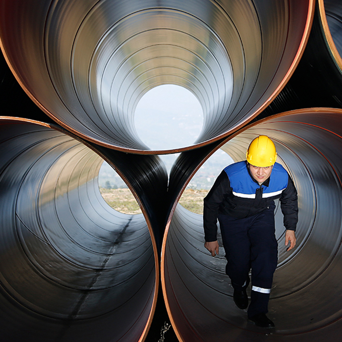 Man walking through industrial tube