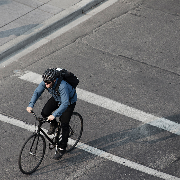 high angle view of male commuter riding a bicycle to work