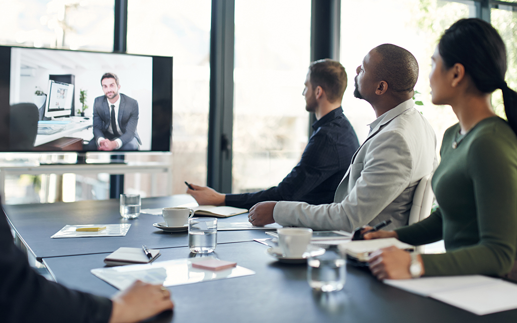 Buisnessman on screen during a broadcasted meeting