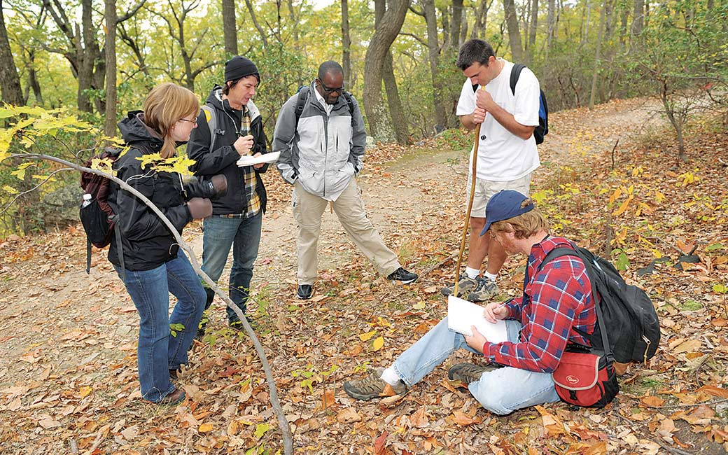 biology students outdoors conducting research