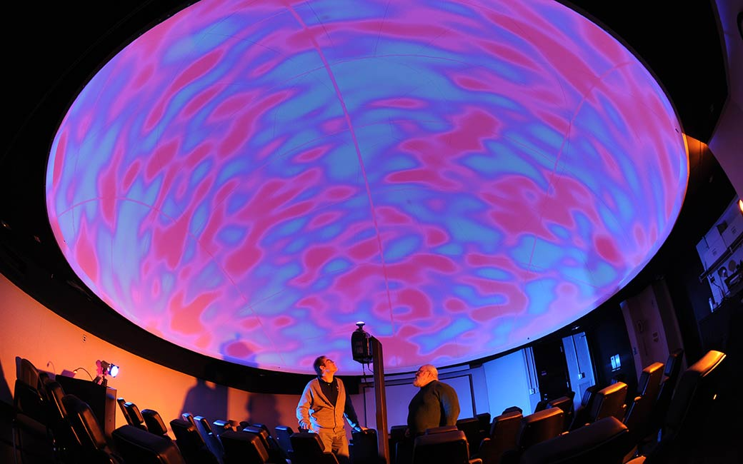 faculty members in planetarium