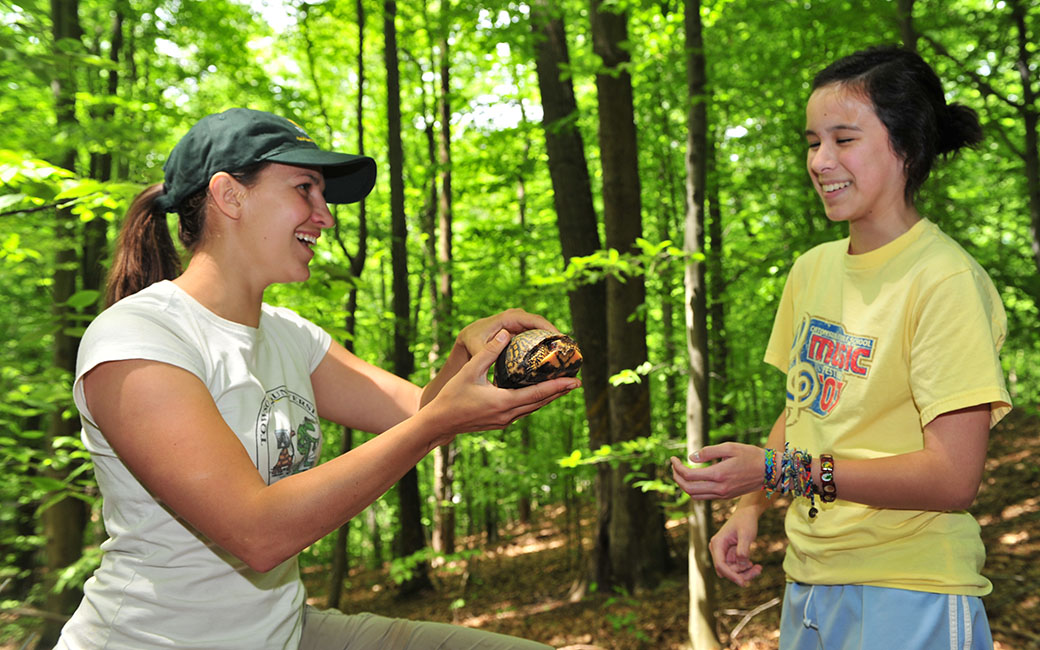 students with a turtle at the Towson Field Station