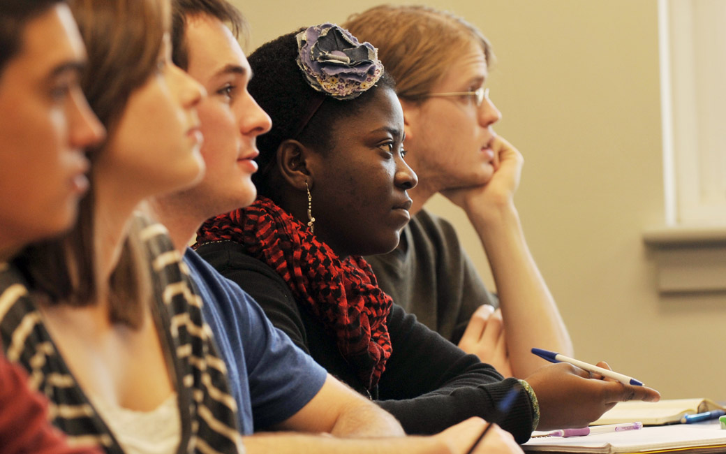 Diverse group of five students seated in class listening to a presentation