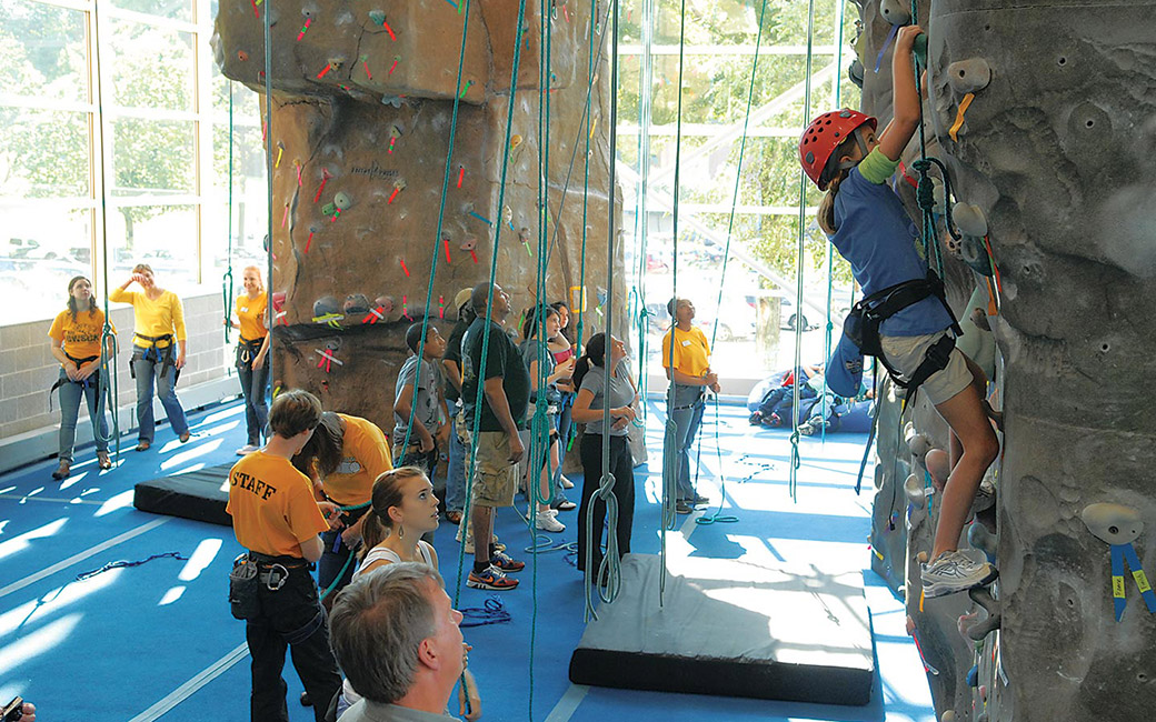 Students climbing the Rock Wall at Burdick Hall