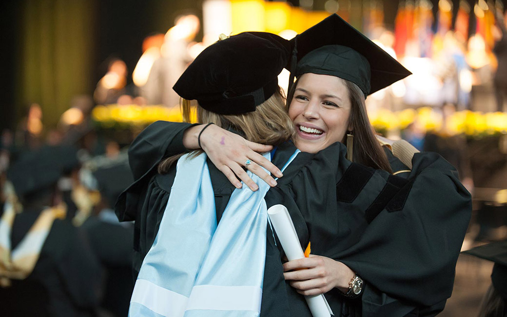 Gratuation students are hugging